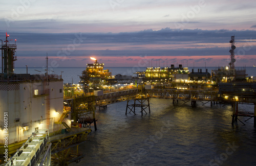 Staande foto Industrial geb. An offshore oil-platform with gas flare during sunset