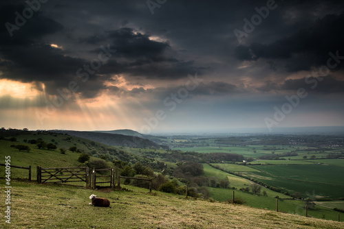 Spoed Foto op Canvas Grijze traf. Sunset landscape across English countryside with dramatic sky