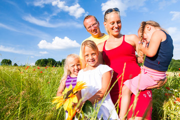 Family in grass in summer