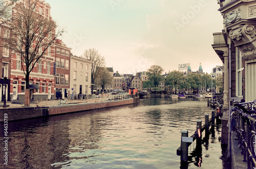Photo  Beautiful view of Amsterdam canals with bridge and typical dutch