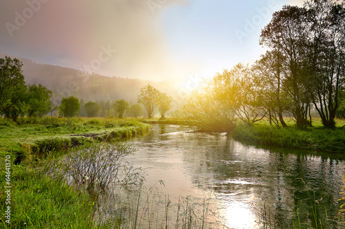 Keuken foto achterwand Honing Sunrise on a smal river with fog