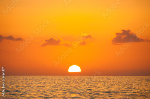 Fabulous sunset on a background of sky and sea.