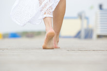 Low Angle Barefoot Woman Walki...