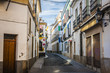 Typical cobbled mediterranean street of white houses in Cordoba
