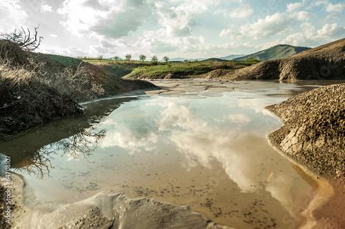 Deurstickers Droogte Small lake near muddy volcanoes