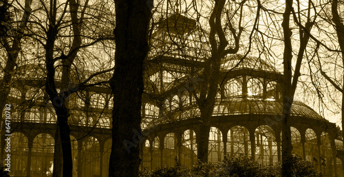 Antique glass building with trees in sepia tone