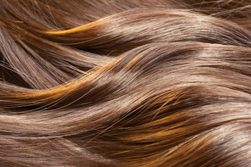 Beautiful healthy shiny hair texture with highlighted streaks