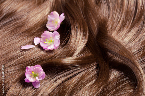 Beautiful healthy shiny hair with sakura flowers