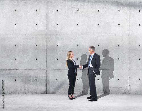 Photo Business Handshake on an Industrial Building