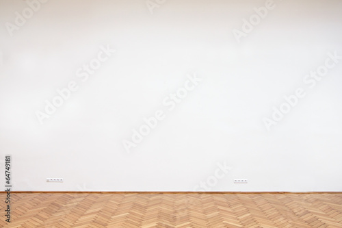Fotografie, Obraz  Large white wall with wooden floor tiles