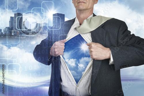 Businessman showing superhero suit underneath his shirt standing Canvas Print