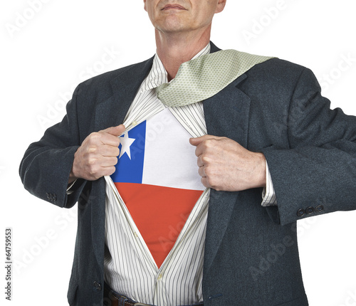 Businessman showing Chile flag superhero suit underneath his shi Canvas Print