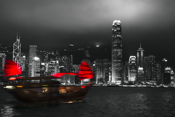 Naklejka Czarno-Biały Hong Kong harbor at night with blurred silhouette of sailboat