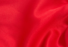 Red Satin Or Silk Fabric As Ba...