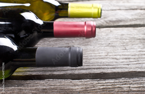 Wine bottles on a wooden table Canvas