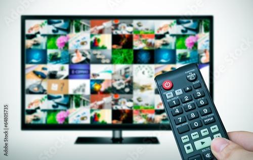 Fototapeta Remote and TV with multiple images gallery obraz na płótnie