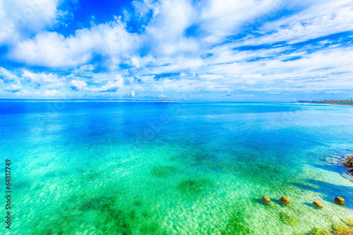 Wall Murals Green coral Beautiful scenery of shining blue sky and ocean in Okinawa