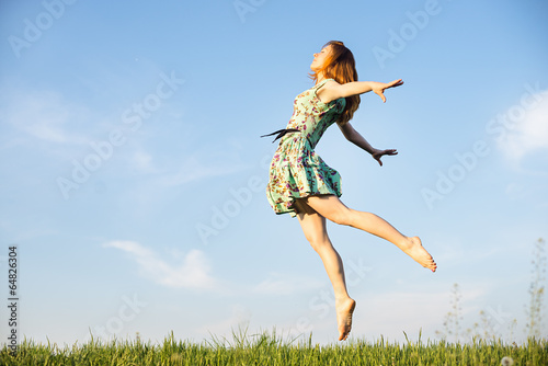 Happy Young Woman Jumping Poster
