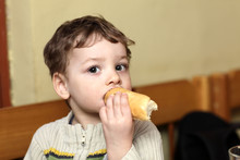 Child Eating Bun