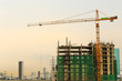 Inside place for tall buildings under construction and cranes u