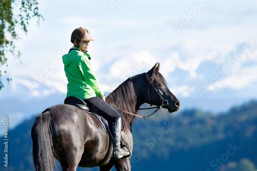 Woman riding horse Tablou Canvas