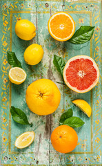 FototapetaCitrus fruits (lemon, grapefruit and orange) on wood