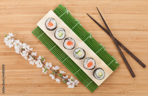 Sushi set with fresh sakura branch