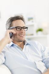 portrait closeup on a man at phone