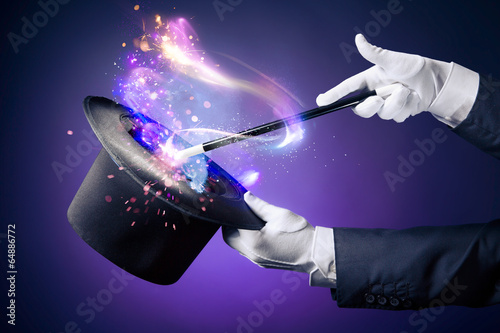 Fotografie, Obraz  High contrast image of magician hand with magic wand