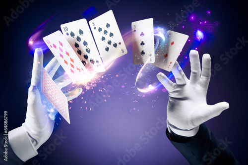 High contrast image of magician making card tricks