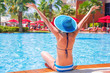 Happy woman on summer holidays at the swimming pool