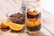 Glass of mixed fresh fruits and raisins