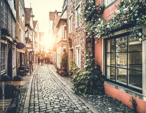 Tuinposter Retro Historic street in Europe at sunset with retro vintage effect