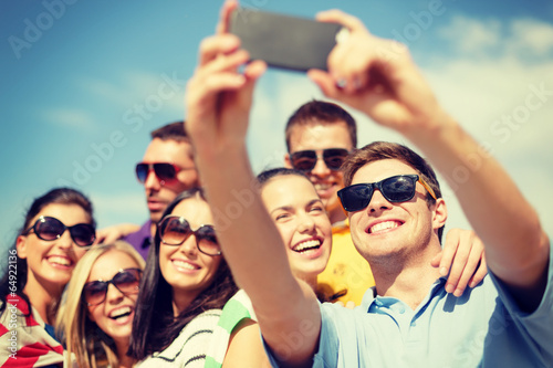 Fotografie, Tablou  group of friends taking picture with smartphone