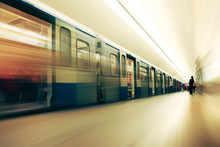 Motion Blurred Commuters  In Subway Station.