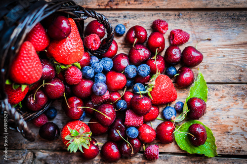 Berries mix on rustic background