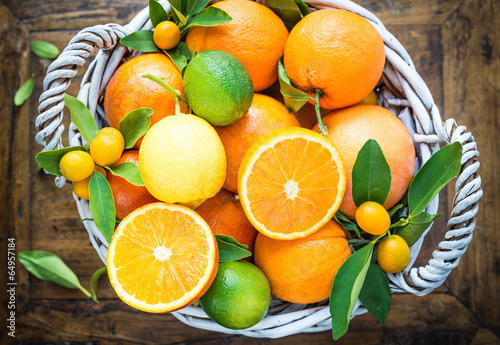 Leinwand Poster Mix of fresh citrus fruits on rustic wood