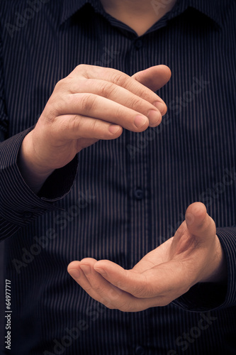 man hand showing size applauding