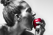 Woman Painted Silver Biting Red Apple