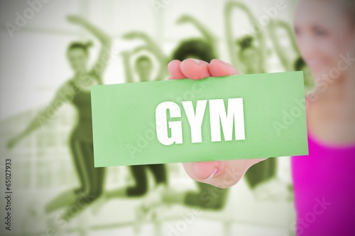 Fit blonde holding card saying gym