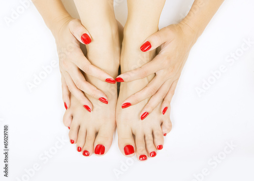 Photo  red manicure and pedicure