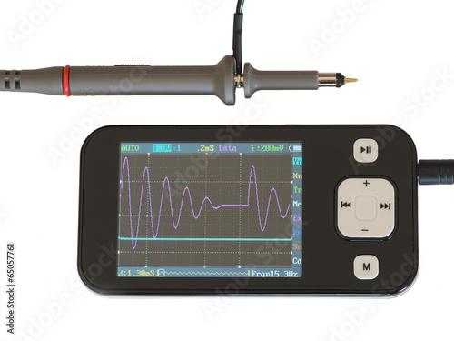 Fotografie, Obraz  A hand held Oscilloscope.