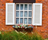 open white window on red brick wall