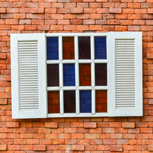 White Window On Red Brick Wall