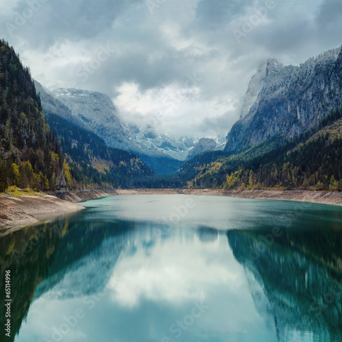 Foto op Canvas Nachtblauw Alpine lake with dramatic sky and mountains. Tirol, Austria