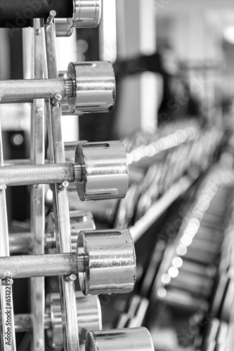iron dumbbells in two rows