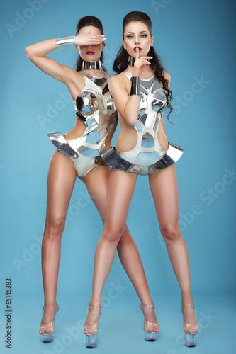 Photo  Extravagance. Two Heeled Women in Futuristic Clubwear. Hangouts