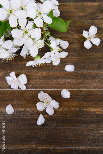 Staande foto Lelietje van dalen Beautiful fruit blossom on wooden background
