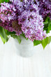 beautiful lilac on white wooden surface