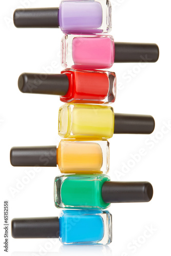 Nail polish bottles colorful stack on white, clipping path Poster